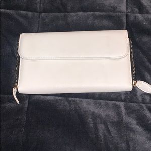 White clutch with gold zipper sides magnet closure